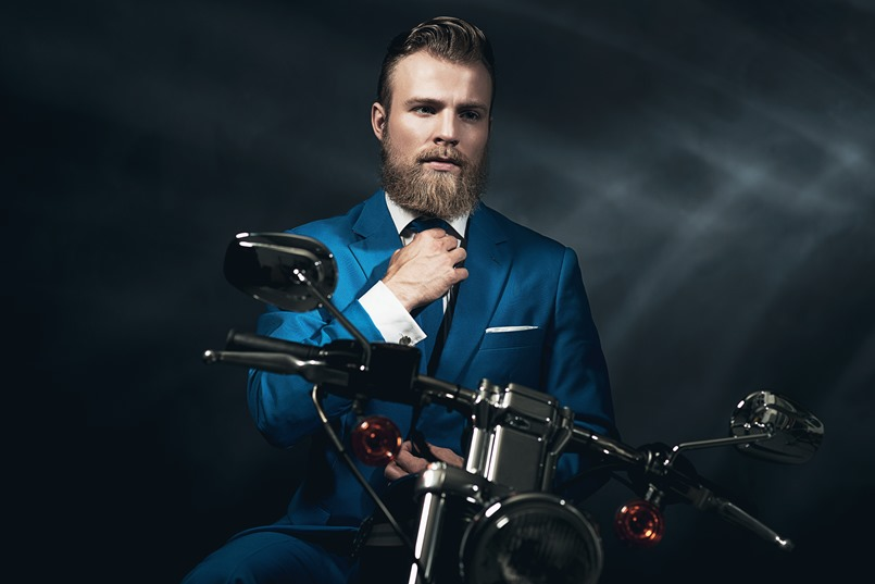 Handsome businessman on a motorbike